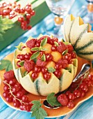 Melon filled with summer fruit