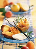 Lemon madeleines with lemon sorbet and apricots poached with rosemary