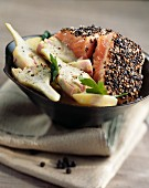 Salmon with pepper crust and artichokes