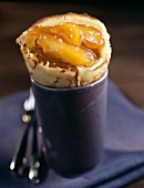 Pancake filled with stewed apricots