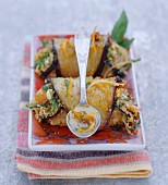 Confit eggplants rolled and filled with semolina and dried fruits