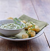 Monkfish fritters with herb sauce