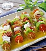 Mini brochettes with raw ham and feta