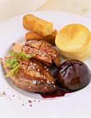 Duck fillets with fig ,polenta and potato croquette