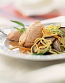 Pike quenelles with sauteed noodles and vegetables
