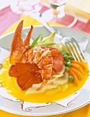 Lobster with baby vegetables in orange sauce