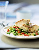 Hake steak with minted broad beans and diced red pepper