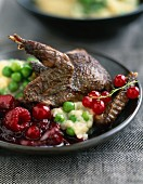 Pigeon with summer fruit and celery purée with peas