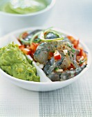 Raw gambas with tomatoes and guacamole