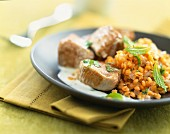 Sautéed pork with red lentils