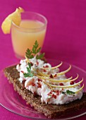 Slice of Sweedish bread with salmon mousse and pink peppercorns