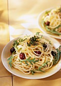 Spaghettis with rocket and basil