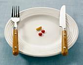 Tabletten auf weißem Teller