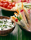 Rice cake and raw vegetable wraps with herb cream dip