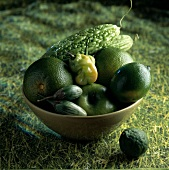 bowl of green fruit and vegetables