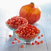 bowls of pomegranate seeds