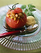 Tomato stuffed with vanilla-flavored vegetables and orange zests