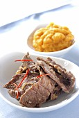 sliced ostrich with pineapple chutney