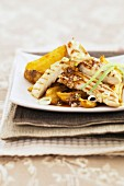 Chicken fillets with barbecue sauce and potatoes
