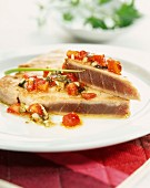 Tuna fillets cooked in the oven with tomatoes