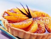 Mürbteigtörtchen mit Creme Brulée und Zitrusfruchtscheiben