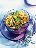 Strips of chicken with Chinese noodles (topic: wok)