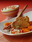 Veal filet mignon with rice, carrots and tomatoes