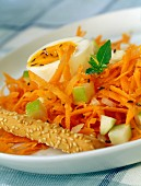 Soft-boiled egg with grated carrots and green apple