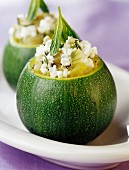 Round courgettes stuffed with ricotta