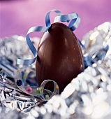 Chocolate Easter egg in aluminium foil