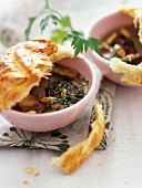 Cream of mushrooms with pinenuts and covered with pastry crust