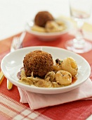 Breaded beef croquette with turnips and onions