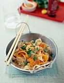 Fried noodles with carrots,sesame seeds and vinegar
