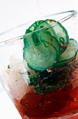 An ice cold vegetable drink with chives and cucumber