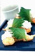 Baked sushi.style prawns with rice and shiso