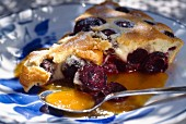 Cherry clafoutis with apricot coulis