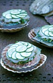 Millefeuilles with scallops and cucumbers served in shells