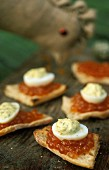 Crostini topped with salmon caviar, quail's eggs and herb mayonnaise