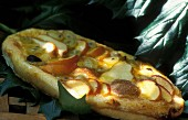 Provençal-style fruit pizza with peaches, pears, grapes and lemon