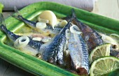 Mackerel in a white wine broth with onions, lemons, garlic and pepper