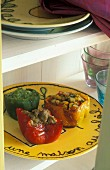 Stuffed Provençal-style peppers on a yellow plate