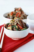 Beef with soya sprouts, peppers and mushrooms
