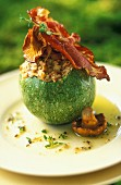 Round courgette stuffed with chanterelles