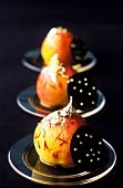 Saffron poached pears with round chocolate wafers