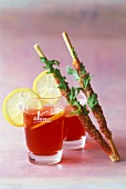 Campari orange with Parma ham and rocket breadsticks
