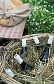 Bottles of wine in hay