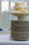 Meringues on a tall stack of plates
