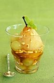 Poached pear with grapes and pinenuts