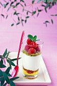 Verrine of honey,fromage blanc mousse with raspberries and pistachios