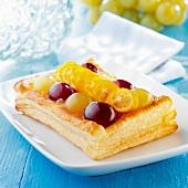 white and black grape puff pastry and kumquats